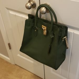 Green Michael Kors bag with gold hardware